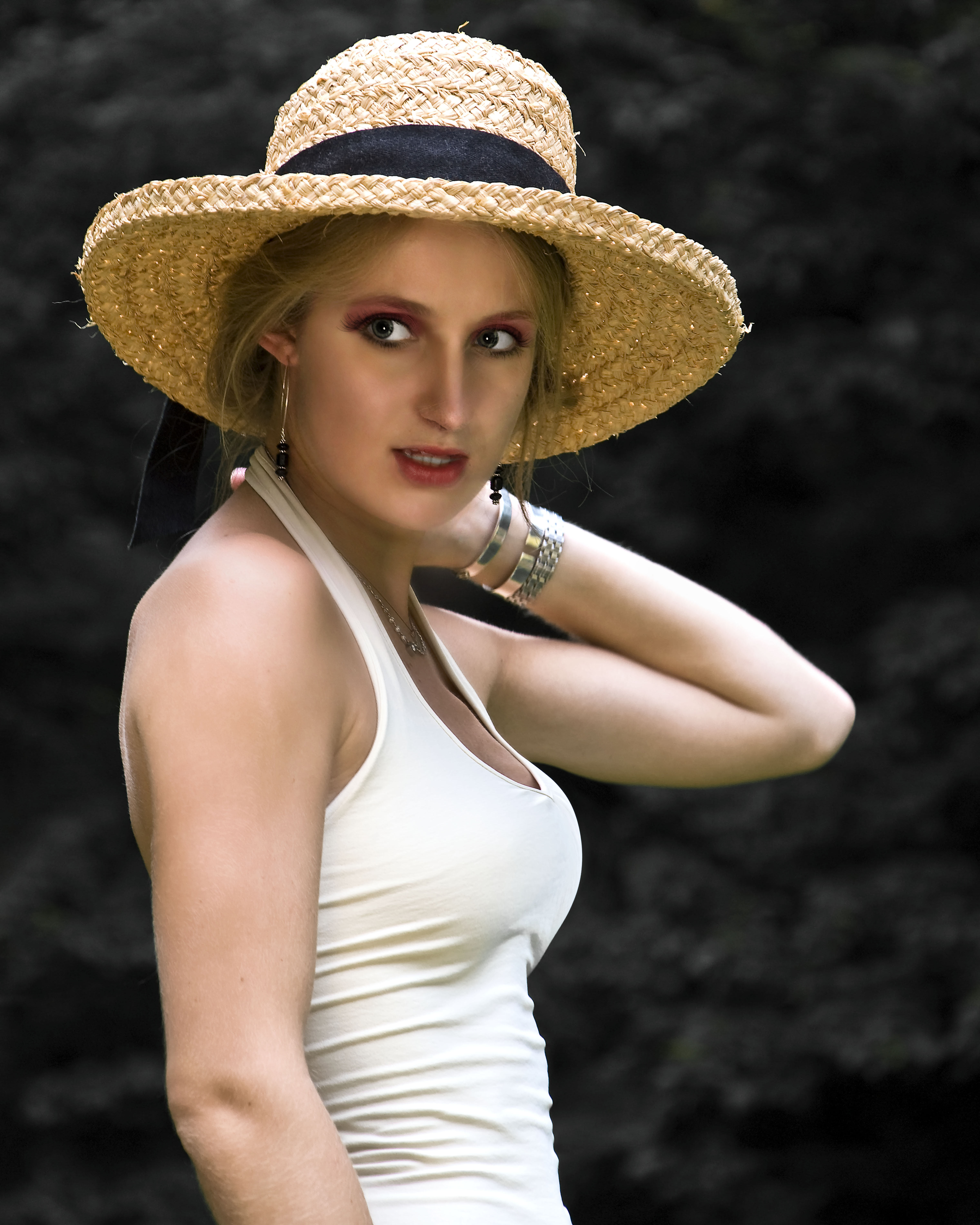 With Straw Hat